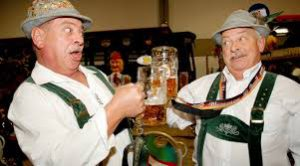 German men enjoying mugs of beer