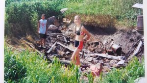 Kelly and Cletus QUINTAL exploring the remains of the HUMBKE farm home in Iowa in 1999